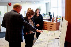 Paul Weist shows Michelle Mungall the architectural drawings for the Nelson Innovation Centre.