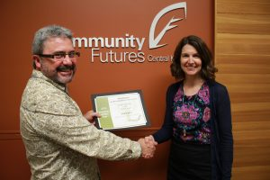 Chris Bell receiving his Community Futures Volunteer of the Year award from Andrea Wilkey, Executive Director of Community Futures Central Kootenay.